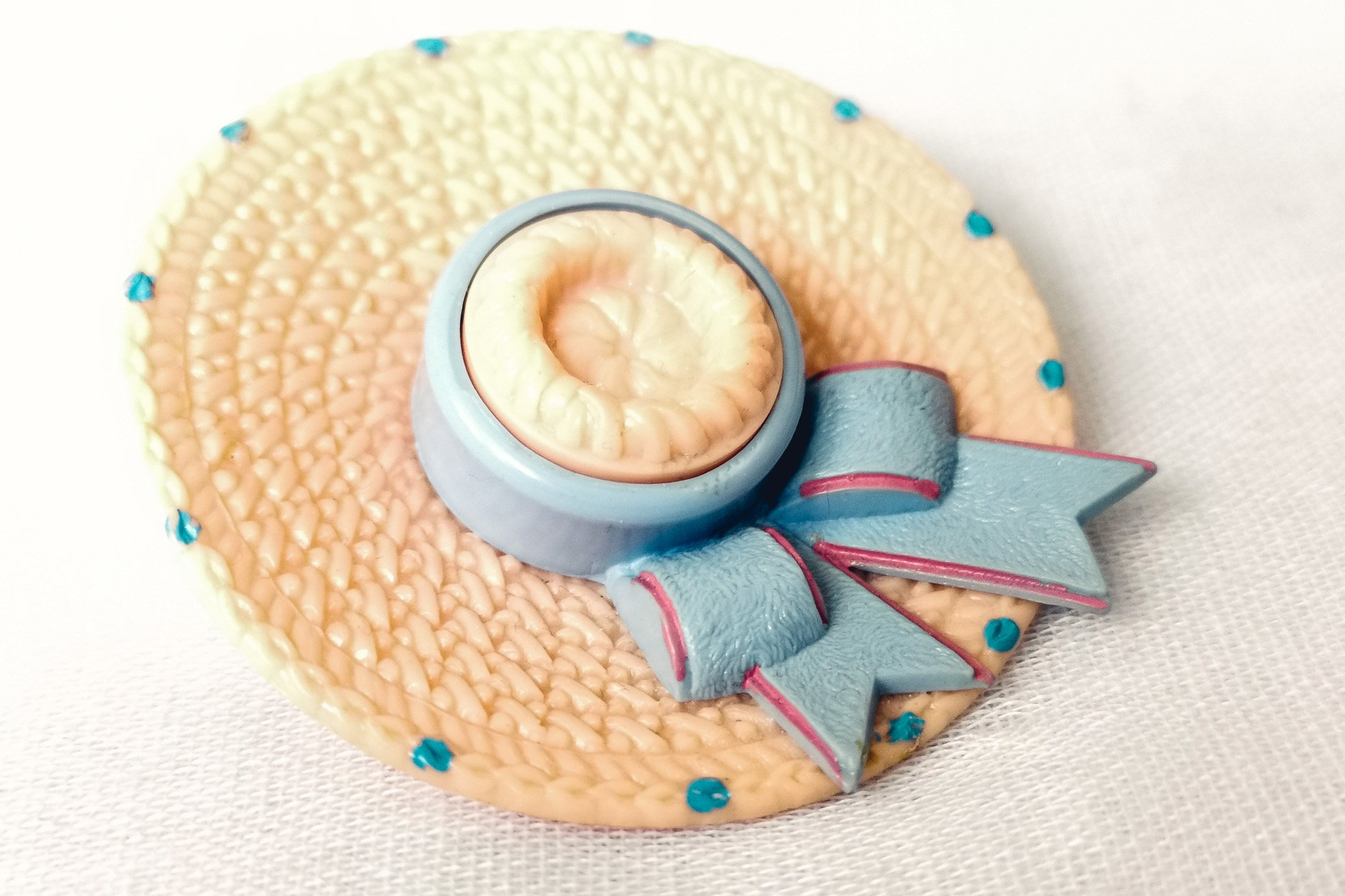 pink and blue plastic straw boater brooch