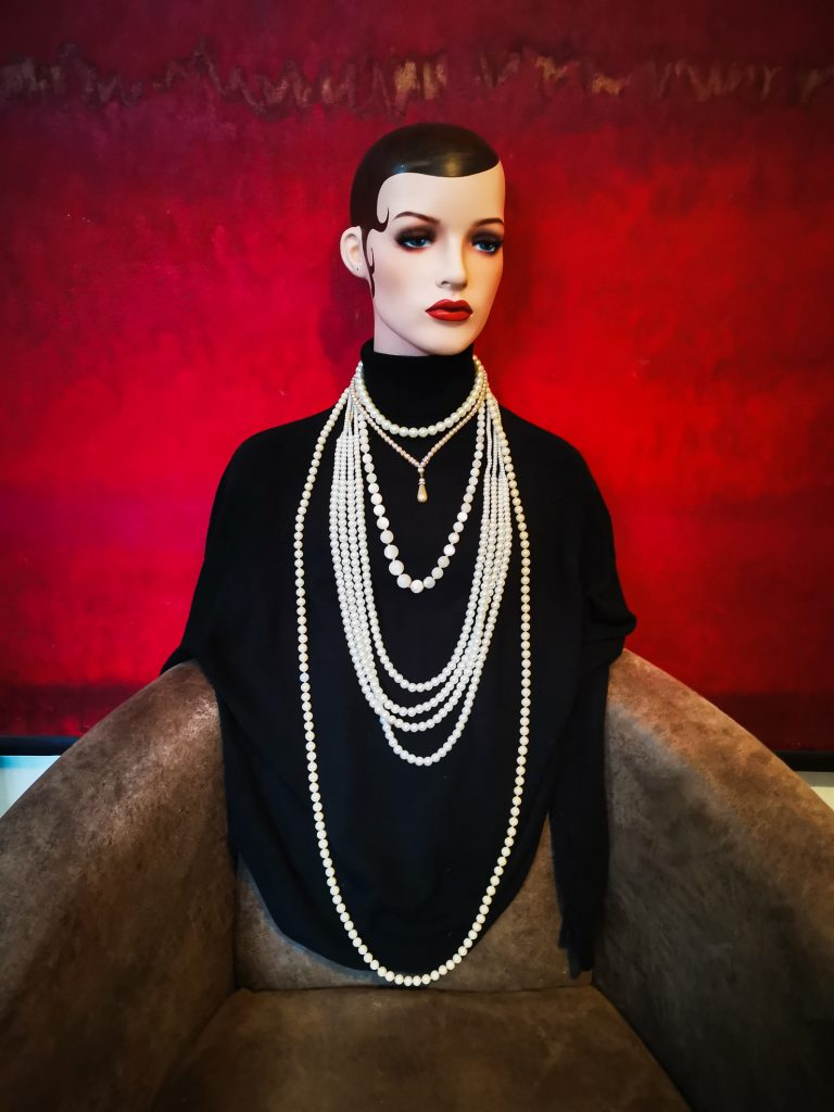 wearing lots of pearls