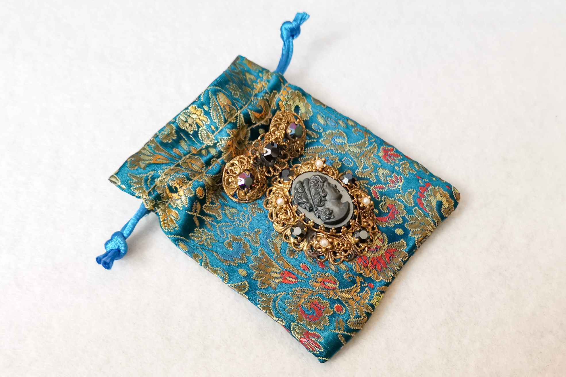 black cameo brooch bag