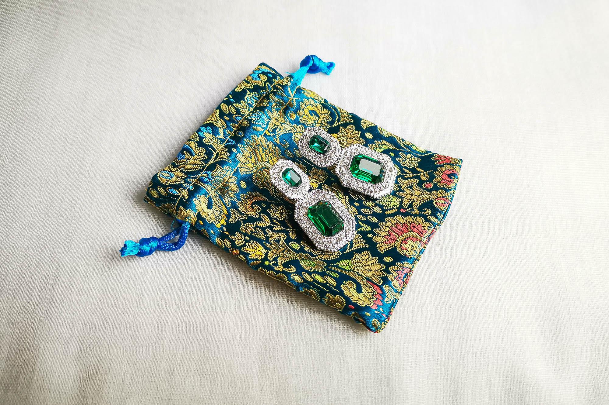 green crystal statement earrings