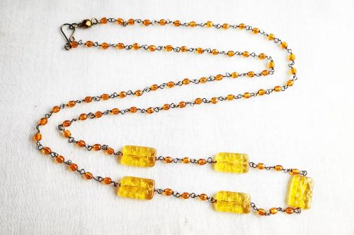 long flapper style amber glass necklace